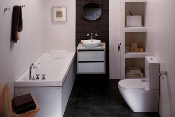 vier STUGVIK Körbe mit Saugnapf in Weiß, die mithilfe · Badezimmer