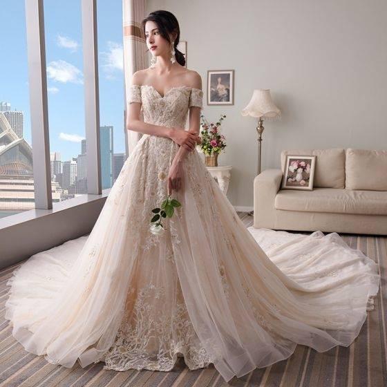 NUOJIA Damen Lang Meerjungfrau Hochzeitskleider Champagner mit Blumen  Appliques Tüll Brautkleider Rücken: Amazon