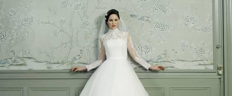 Das Brautkleid GRACE begeistert durch sein transparentes Spitzenoberteil
